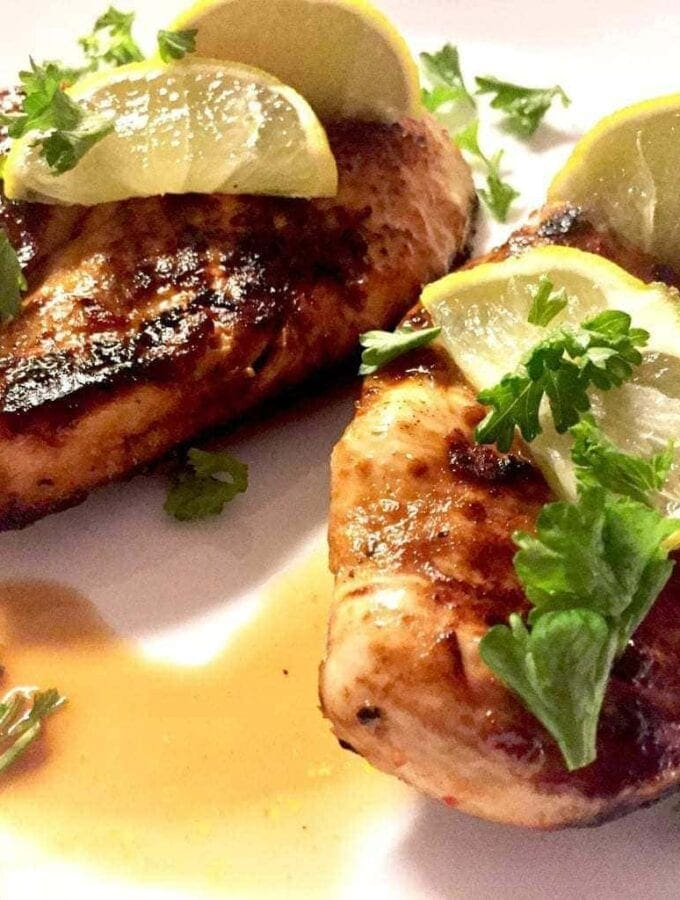 Chile Lime Chicken with limes on a white plate