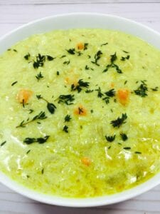 coconut mulligatawny soup in white bowl