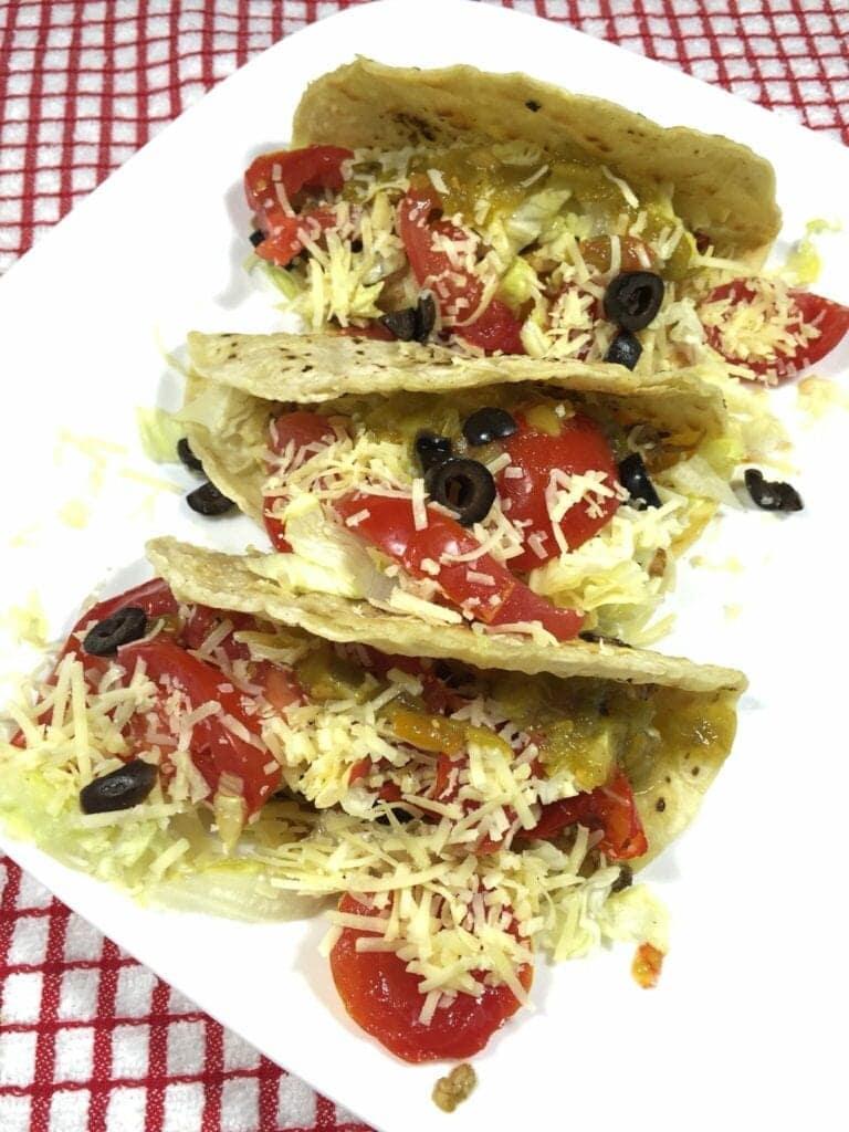 Three pork tacos on a plate