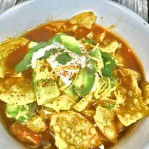 Tortilla soup in a white bowl