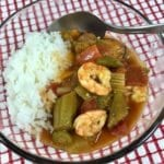 Gumbo with rice in a clear bowl
