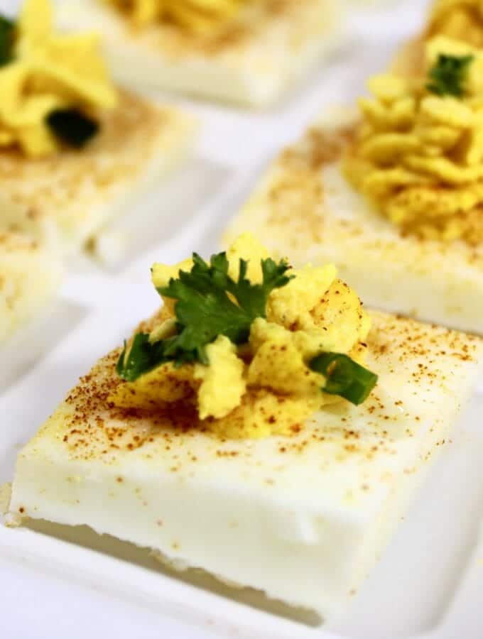 square deviled eggs on a white plate