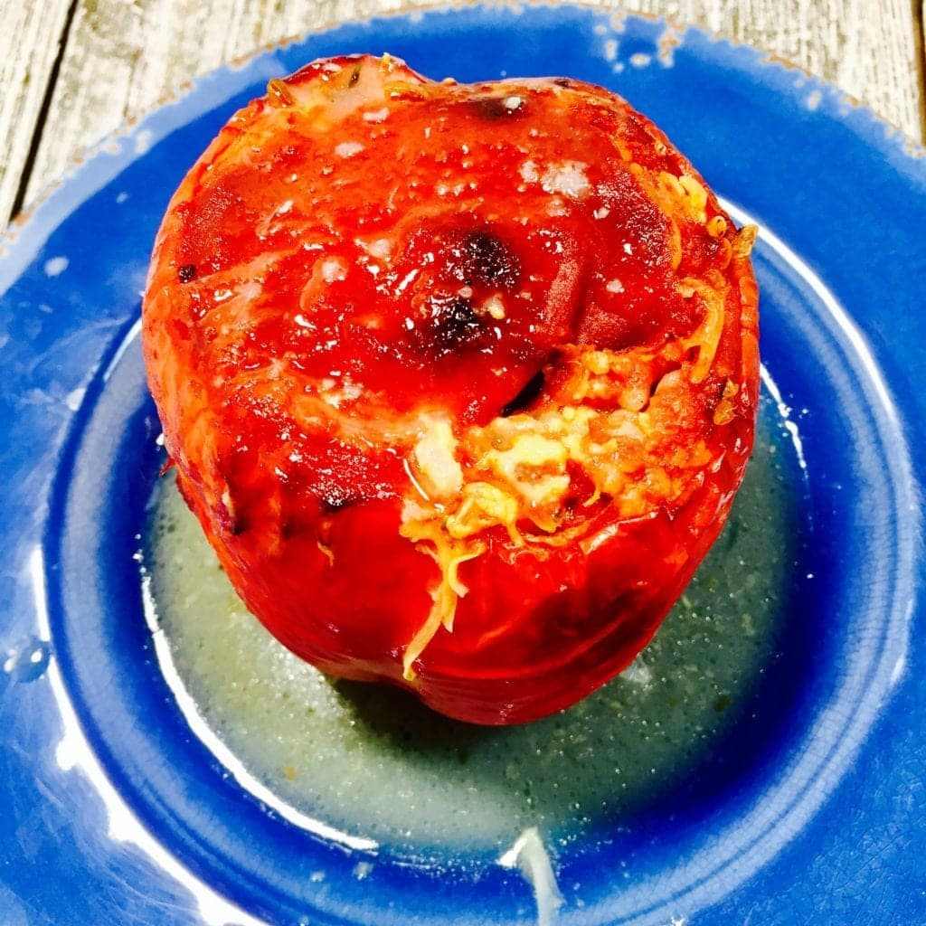baked stuffed pepper on a blue plate