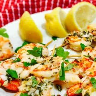 Shrimp Scampi Skewers on a white plate