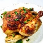 Roast chicken on a white plate