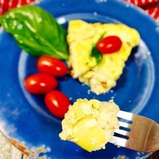 bit on a fork of a frittata on a blue plate