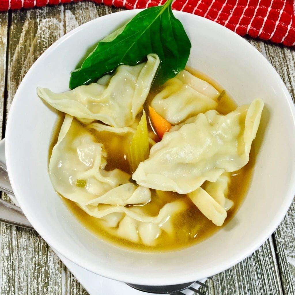 chicken dumpling soup in a white bowl