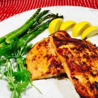 baked salmon on a white plate