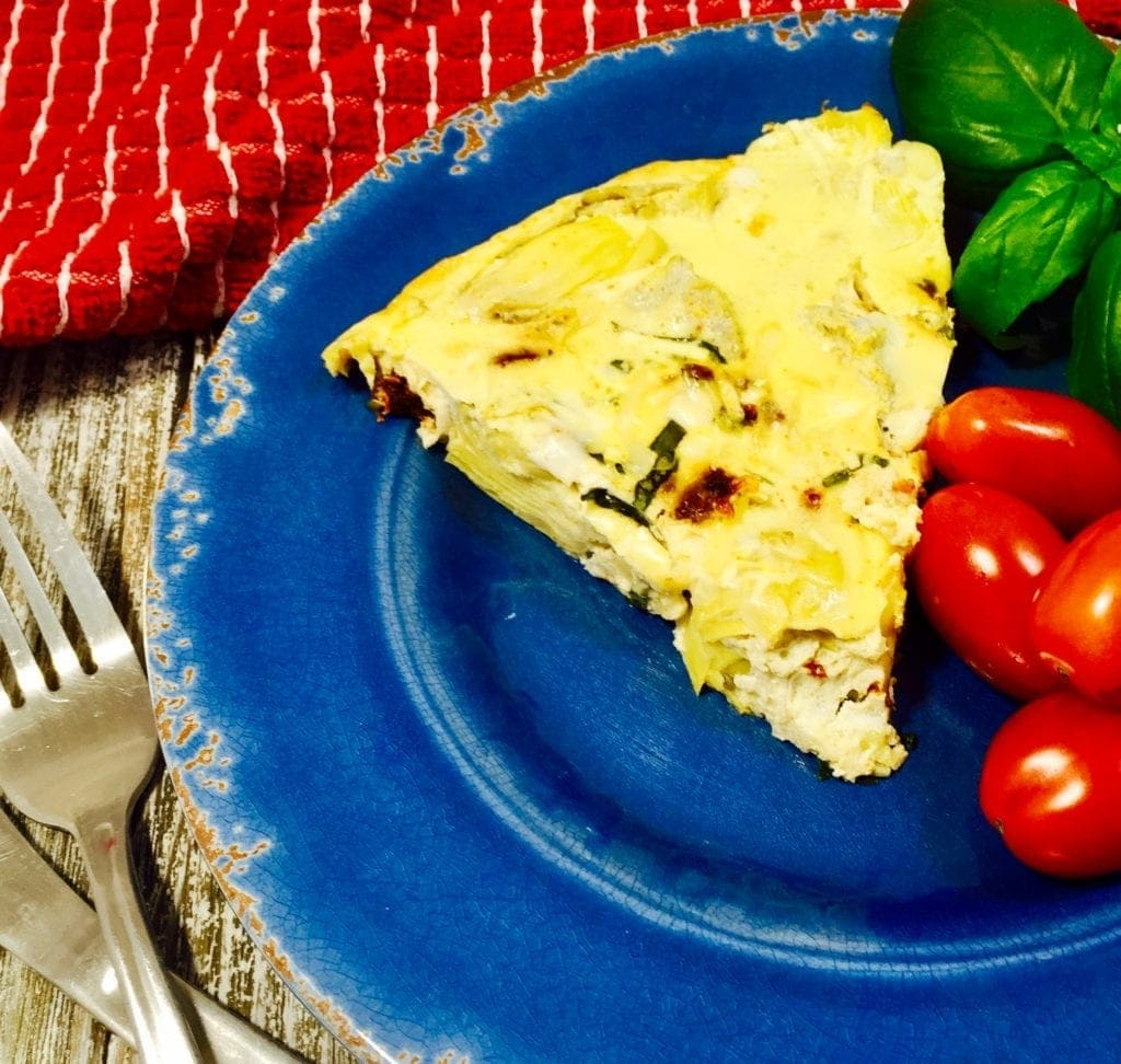 slice of frittata on a blue plate