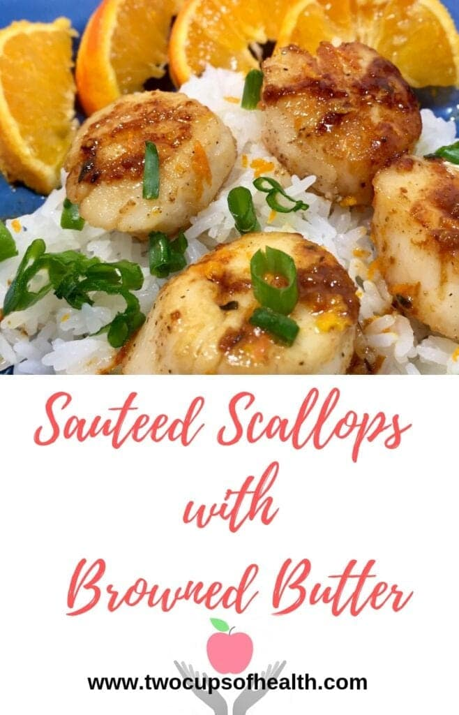 Pinterest pin of Seared Scallops over rice with orange slices on a blue plate