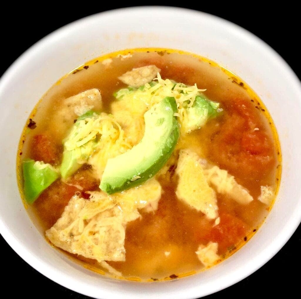 Bowl of Chicken Taco Soup in a white bowl