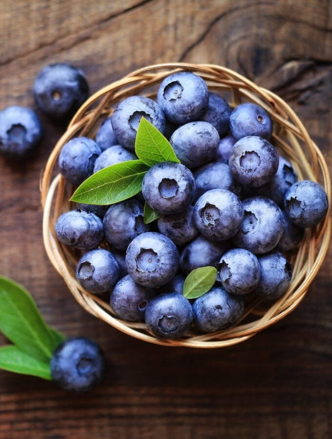 Blueberries in a Basket On a wooden table