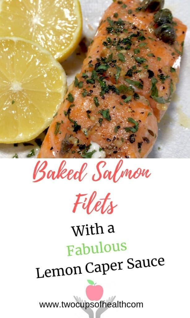 baked salmon fillet with lemons on a white plate