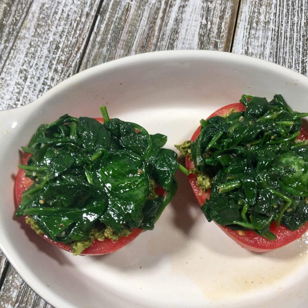 Two tomato halves topped with cooked spinach