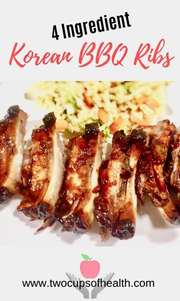 BBQ Ribs with coleslaw on a white plate.