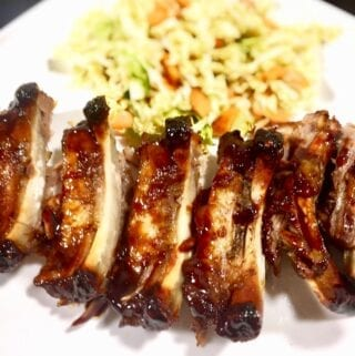 BBQ Ribs with coleslaw on a white plate