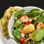 Shrimp salad with ginger dressing in a white bowl