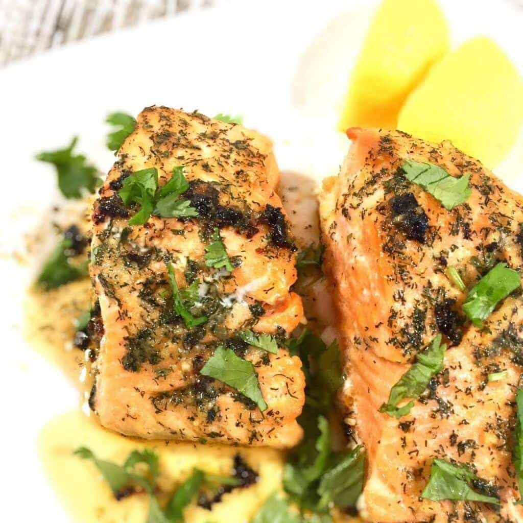 Garlic Butter Salmon on a white plate