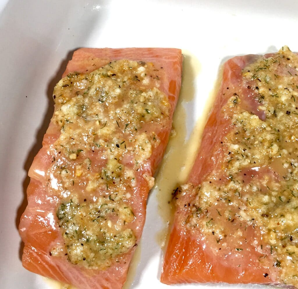 Salmon with a garlic butter sauce ready to be baked