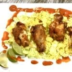Baked chili lime chicken wings on a bed of lettuce