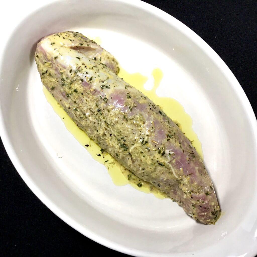 Marinated pork tenderloin in a baking dish