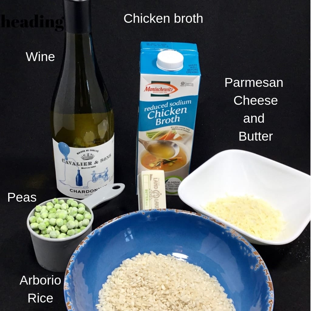 Ingredients for Risotto with Peas - wine, chicken broth, Parmesan cheese, butter Peas and arborio rice on a black background