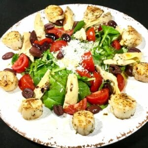 Scallop Salad with Grilled Artichokes on a white plate