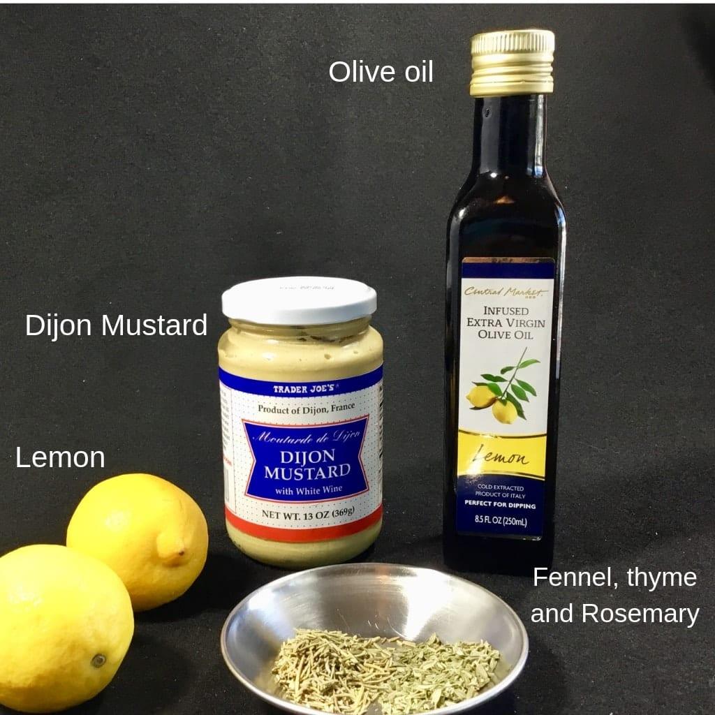 Marinade ingredients: lemon, Dijon mustard, herbs and olive oil for pork