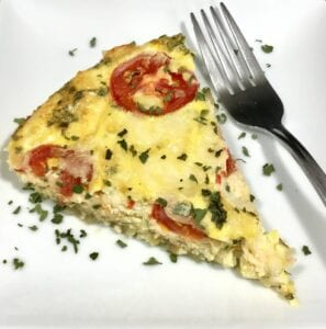 Amazing Zucchini and Potato Frittata on a white plate