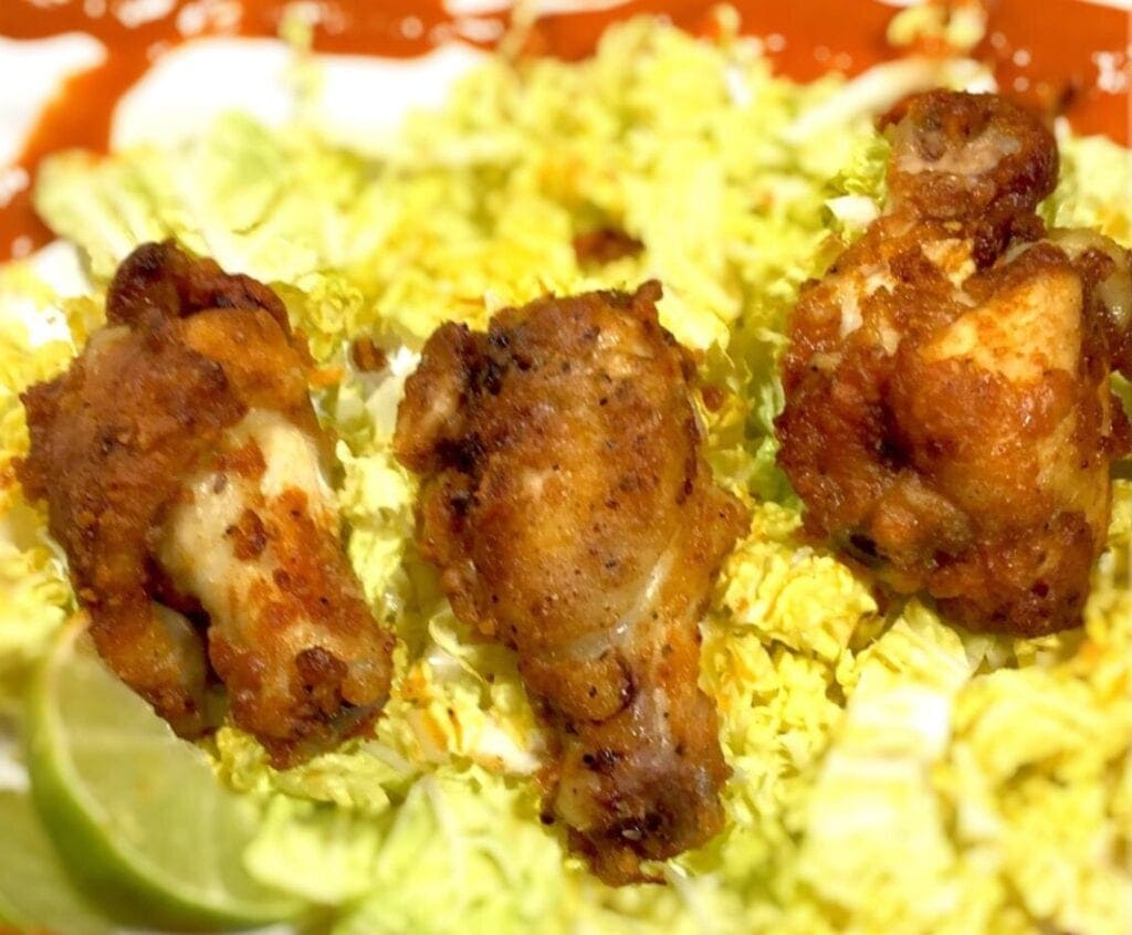 Chili Lime Wings on a bed of shredded cabbage