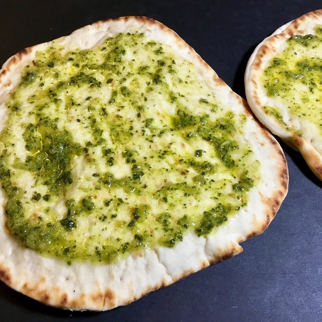 basil, garlic and olive oil spread on naan bread