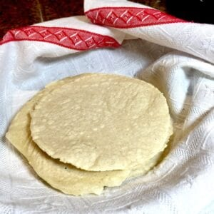 Homemade tortillas in a white towel