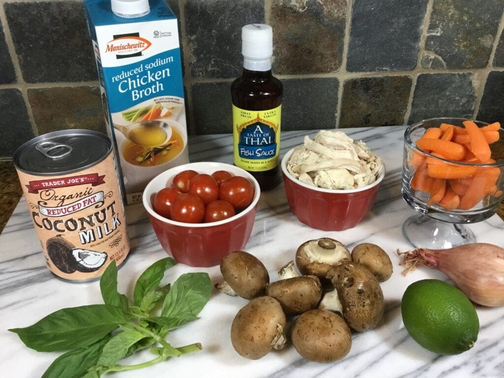 Ingredients for Thai Chicken Soup on a marble tray