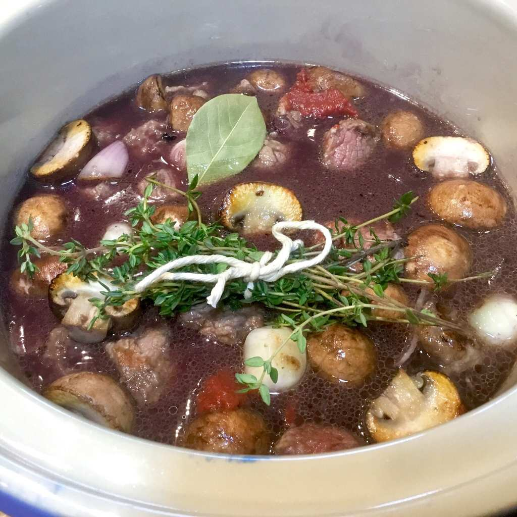 Beef Bourguignon simmering in a Crockpot