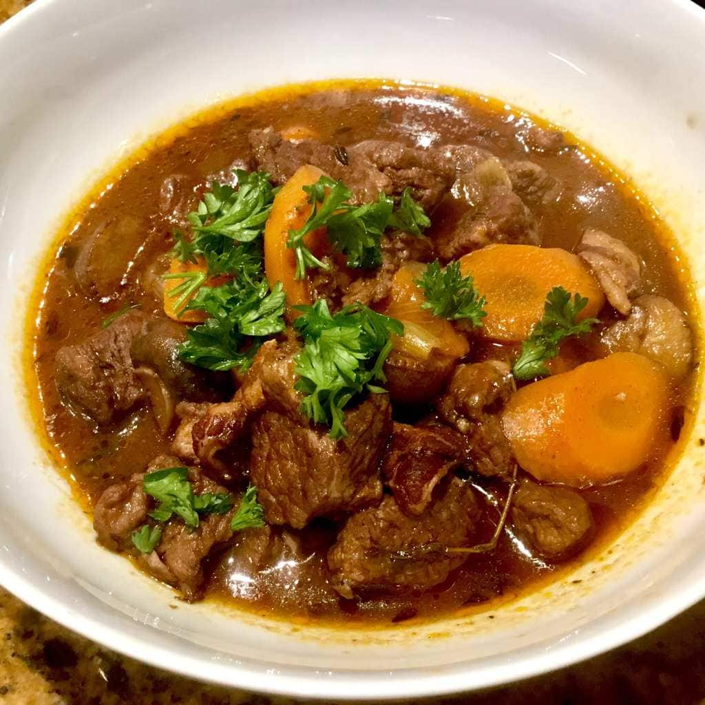 Beef Bourguignon in a white bowl