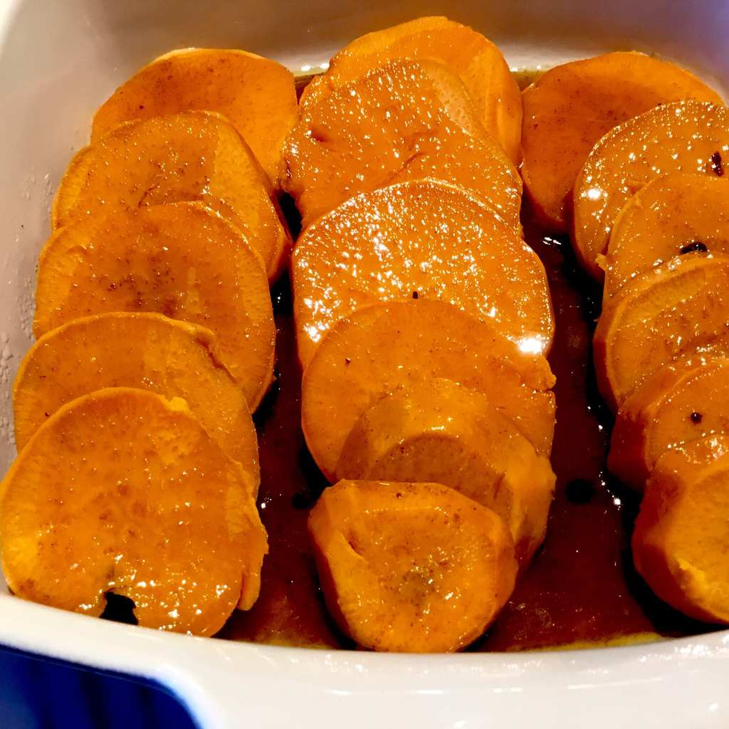 Sliced Sweet Potatoes in a baking dish