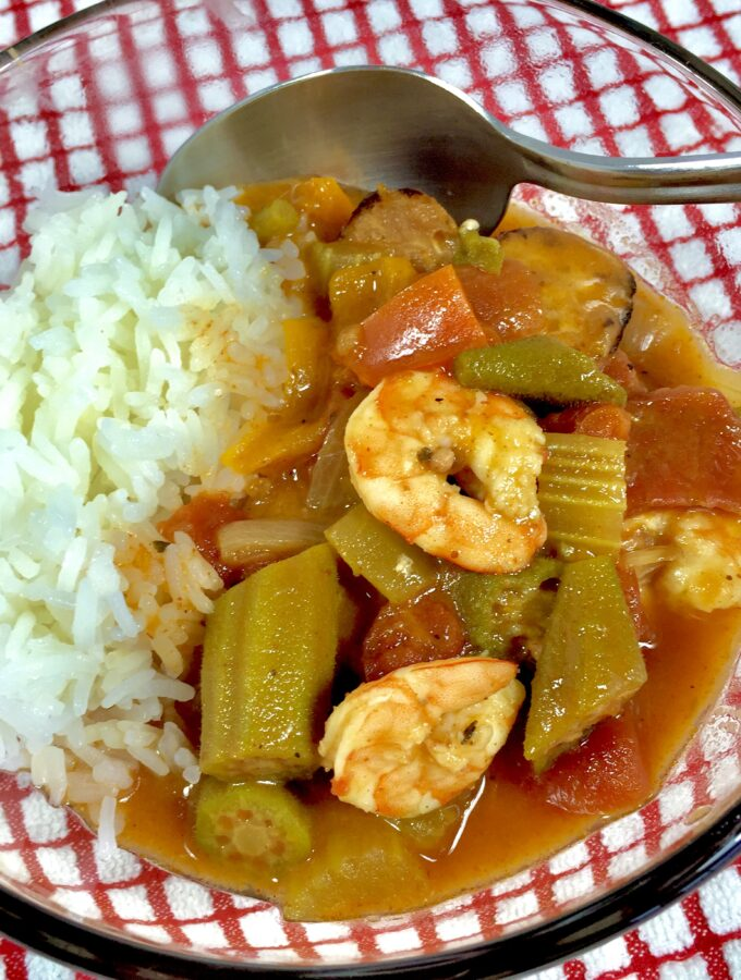 Lite Shrimp Gumbo in a clear bowl with a red and white checked towel