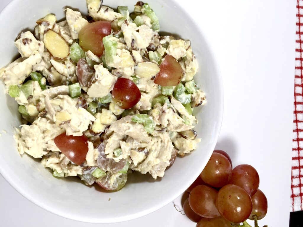 Best Ever Smoked Chicken Salad in a white bowl with Red grapes